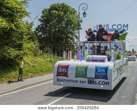Sainte Marguerite sur Mer France - July 09 2015: Ibis Hotels Caravan during the passing of Publicity Caravan before the stage 6 of Le Tour de France 2015 on 09 July 2015. Ibis Hotels is an international chain of convenient hotels.