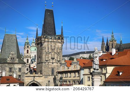 View of the Lesser Bridge Tower and St. Vitus Cathedral and Cathedral of Saint Nicolas from the Charles Bridge (Karluv Most) in Prague Czech Republic