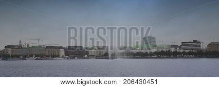 Panoramic view of famous Binnenalster (Inner Alster Lake) in Stormy clouds over the modern city in Hamburg Germany