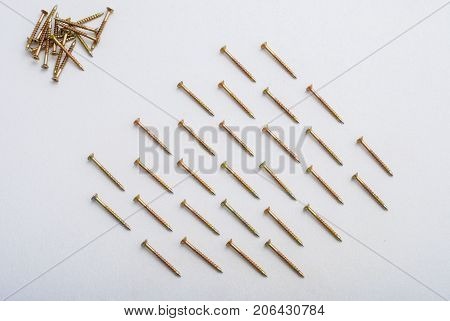 Dowels lying in rhythm on white background