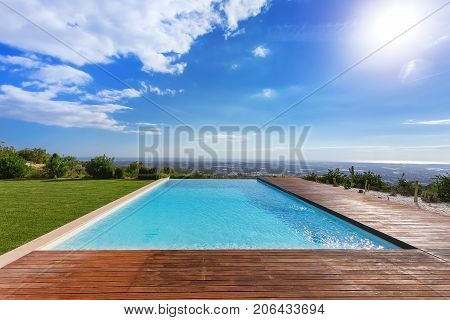 Modern endless infinity pool. With views of the landscape.