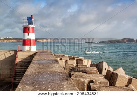 Breakwater with a lighthouse to guide. port Bay Sagres Portugal