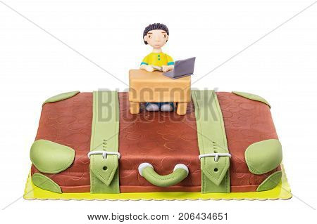 Cake a suitcase with a man from sugar paste. On birthday.
