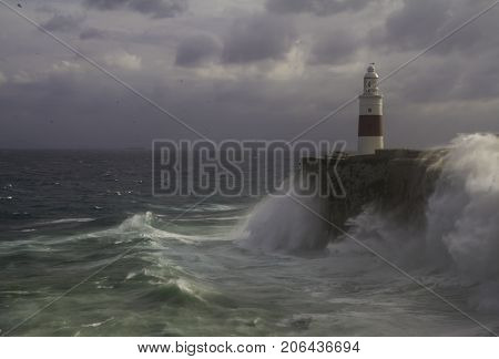 Stormy Seas Lashing the Rock of Gibraltar Lighthouse