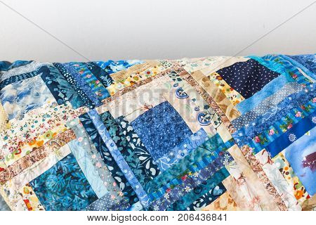 sewing, quilting, creation, culture, needlework concept - small long pieces of satin cloth with various patterns sewed in forms of squares in great colorful blanket, there is free space for text