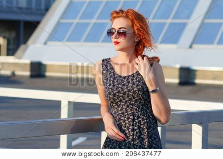 Young Beautiful Girl With Beautiful Appearance. Red-haired Woman With A Pretty Face At Sunset. A Cha