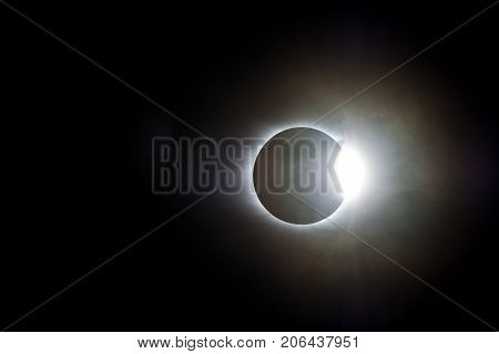 The Sun Emerges From Behind The Moon On A Cloudy Day