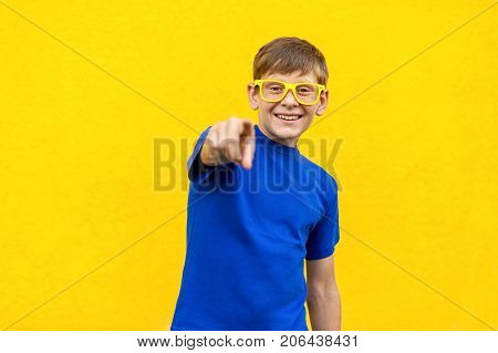 Hey You!happiness Freckled Boy In Yellow Glasses, Pointing Finger And Looking At Camera.
