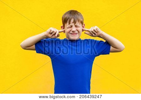 I Dont Want  Hear  You! Sadness Ginger Boy Holding Fingers On Ears And   Closed Eyes.
