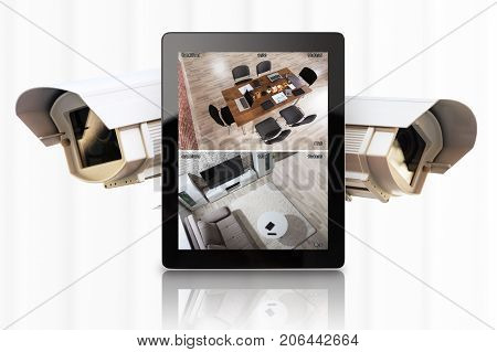 Tablet With Video Footage And CCTV Camera Against White Background