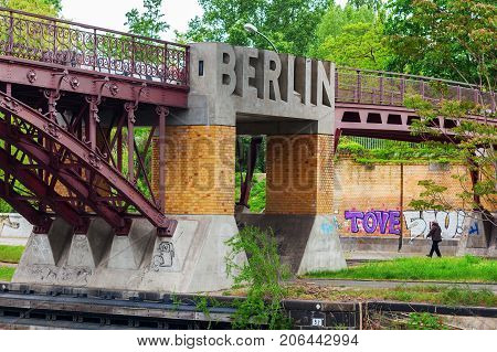 Berlin Germany - May 15 2016: Bridge over river Spree with sculpted word Berlin. Berlin capital of Germany with 3.5 million inhabitants is a global city of culture politics media and sciences