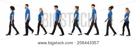 Group Of Janitors Walking In A Row Over White Background