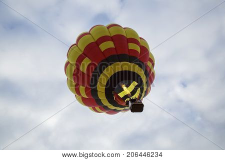 Bristol, UK: August 14, 2016: Flying a balloon at the Bristol International Balloon Fiesta. The annual event has become Europe's largest hot air balloon festival.
