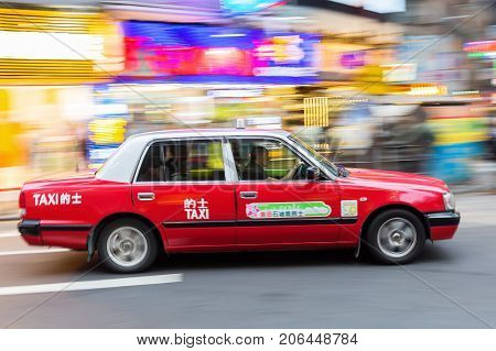 Typical Taxi In Hong Kong In Motion Blur