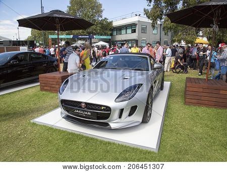 Melbourne, Australia: March 25, 2017: Jaguar F Type Coupe sports car on display at Melbourne's Albert Park. Car enthusiasts look admiringly at the super car