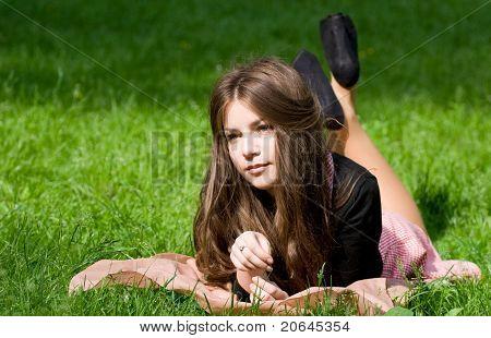 Girl Lying In Th Park