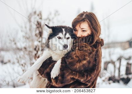 Pretty Husky Dog Outdoor In Womans Hands
