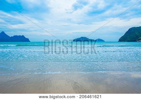 Sea wave foam on Karon beach Phuket Thailand. Exotic paradise of Thailand beach Asia. Peaceful ocean wave at beach. Perfect resort for relax. Ocean wave. Sea waves on beach. Sea beach
