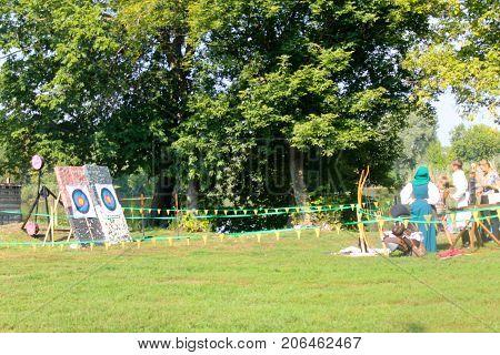 Myrhorod, Ukraine - August 20 2016: People practicing archery on festival of blacksmiths