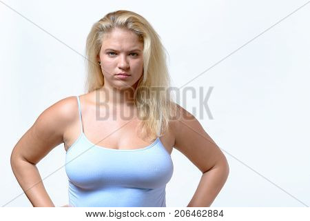 Sulky Cross Young Woman With Hands On Hips