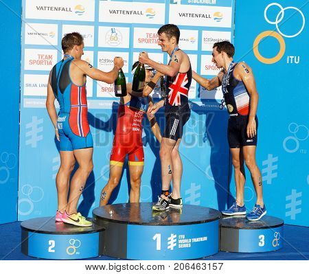 STOCKHOLM - AUG 26 2017: Jonathan Brownlee Kristian Blummenfelt and Pierre le Corre drinking champagne on the winner's stand in the Men's ITU World Triathlon series event Augist 26 2017 in Stockholm Sweden