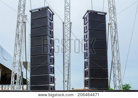Loudspeaker in front of a stage for a music festival