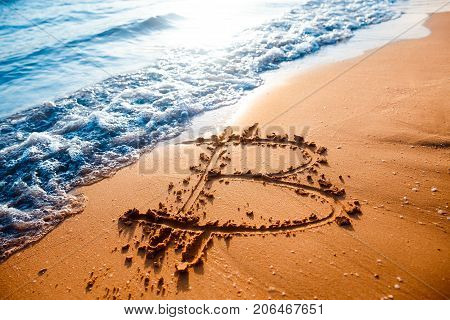 Icon bitcoin on golden sand, in background sea. Concept freelance, stock exchange.