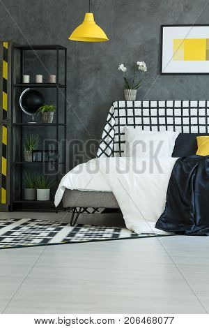 Contrast Bedroom With Yellow Lamp