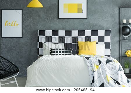 Yellow Dark Bedroom With Posters