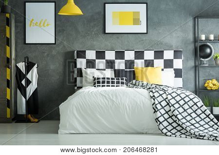 Yellow Accent In Dark Bedroom