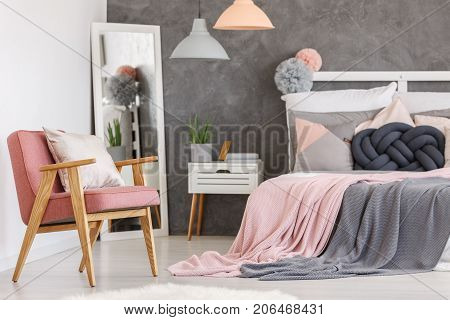 Pink Chair In Girls Bedroom