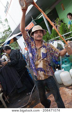 BANGKOK THAILAND - DECEMBER 22 2007 : The Chatuchak Weekend Market is the largest market in Thailand. a man prepares an Indonesian milk tea
