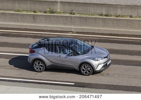Frankfurt Germany - Sep 19 2017: Toyota C-HR hybrid subcompact crossover suv driving on the highway in Germany