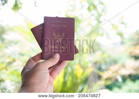 book and passport on bokeh background. Thailand passport.