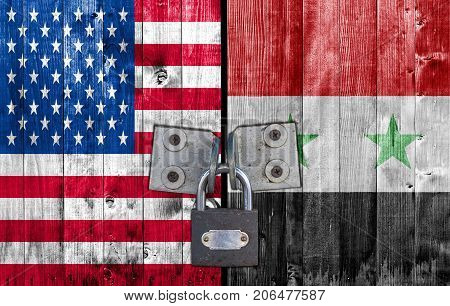 US and Syria flag on door with padlock