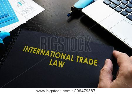International trade law and notebook on a table.