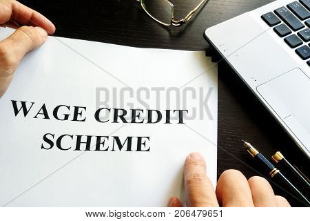 Papers with Wage Credit Scheme WCS on a table.
