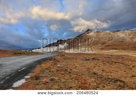 Landscape of steaming fumaroles in geothermal valley Hverir Namafjall in north Iceland