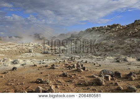 Steaming fumaroles in geothermal valley Hverir Namafjall in Iceland