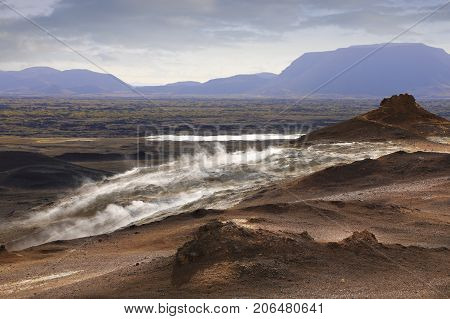 Amazing view of steaming sulfur fumaroles in Hverir Namafjall geothermal place in Iceland