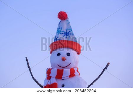 Winter activity and party. Christmas or xmas decoration. New year snowman from white snow outdoor. Happy holiday and celebration. Snowman with in hat and scarf
