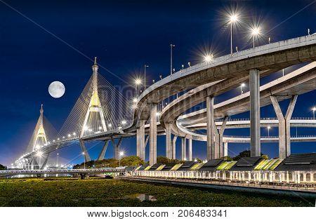 BANGKOK THAILAND - JUNE 05: Interchange to Industrial Ring Road suspension bridge in the evening