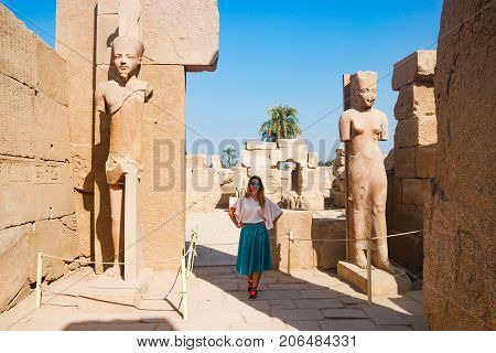 Admiring statues near famous ancient temple in Luxor, Egypt