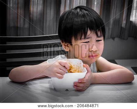 Asian Boy Making Repulsive Expression While Eating
