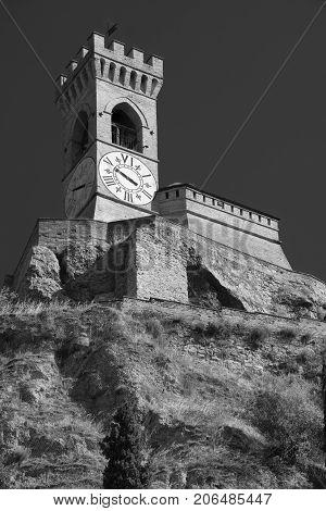 Brisighella (Ravenna Emilia Romagna Italy): historic buildings in the Guglielmo Marconi square: tower. Black and white