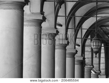 Bologna (Emilia Romagna Italy): detail of a typical old portico. black and white