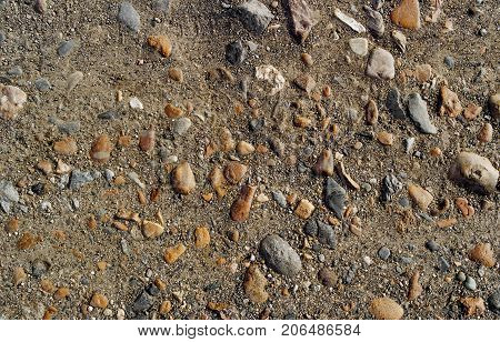 Soil. Ground texture. Soil background. Abstract nature pattern. Stony land. Ground background