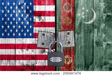 US and Turkmenistan flag on door with padlock