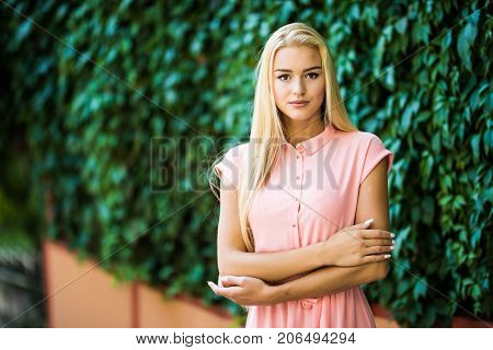 Young Woman, Against Background Of Summer Green Park, Green Leaves.
