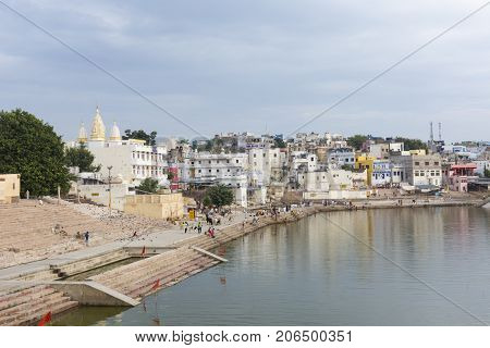 Pushkar, India - September 17, 2017: Hindu Devotees Pilgrims Bathing In Sacred Puskhar Lake (sagar)